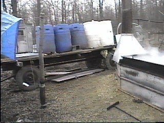 Barrels of Maple Sap and the Evaporator